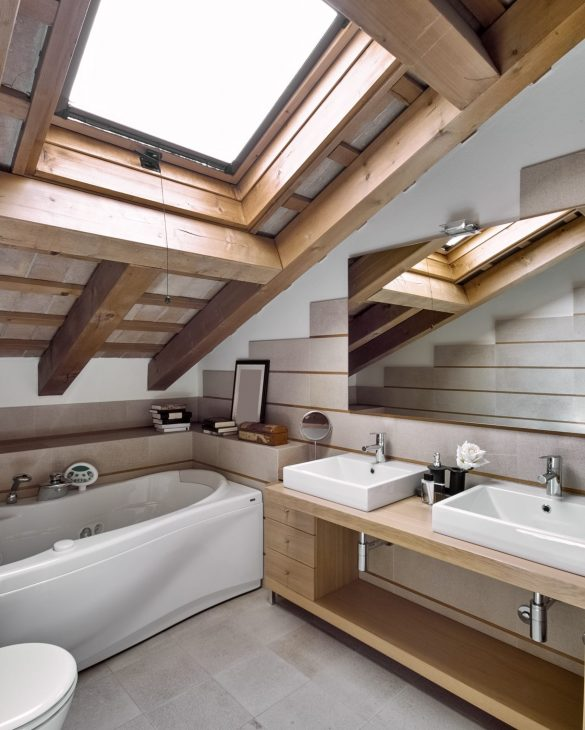 interior view of a modern bathroom in the attic room in foreground the countertop washbasin