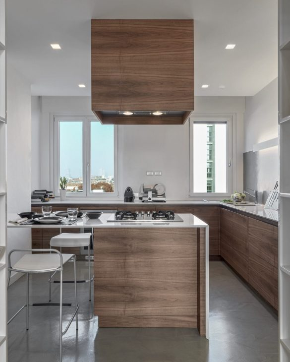 interiors of a modern kitchen with island kitchen the floor is made of concrete