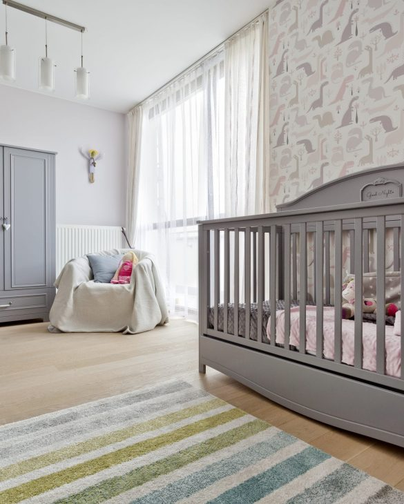 Cozy old fashioned nursery with wooden grey cradle