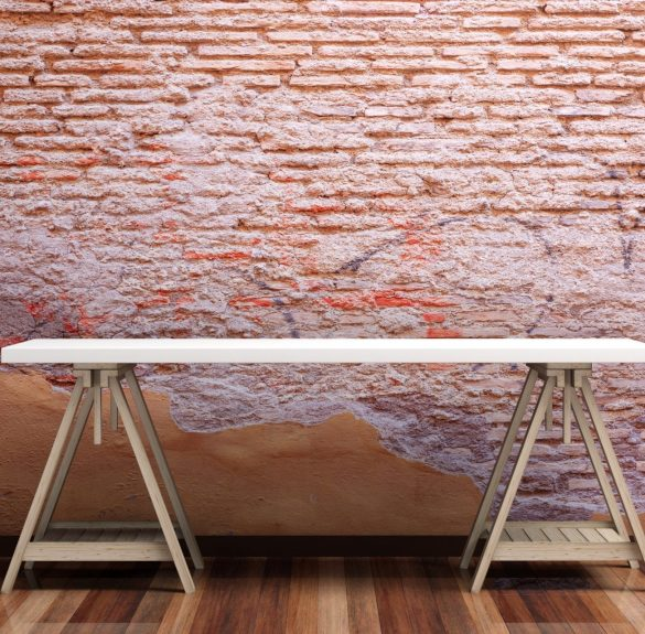 Office desk on a wooden floor - distressed brick wall. 3d illustration